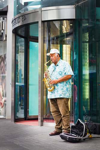 people man standing playing saxophone human