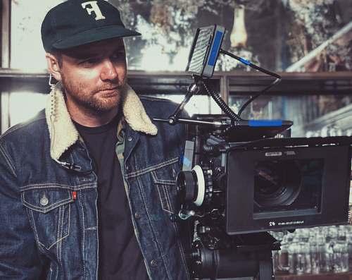human man taking video using studio camera people