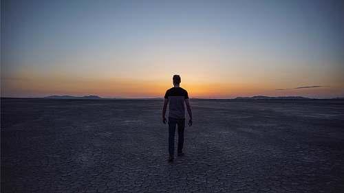 human man walking on desert people