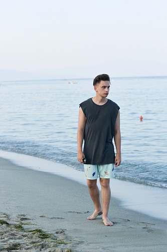 human man walking on shore people