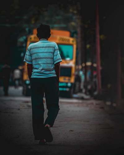 human man walking towards the truck people