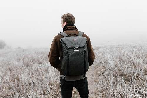people man wearing backpack walking on pathway human