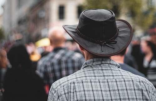 people man wearing black cowboy hat hat