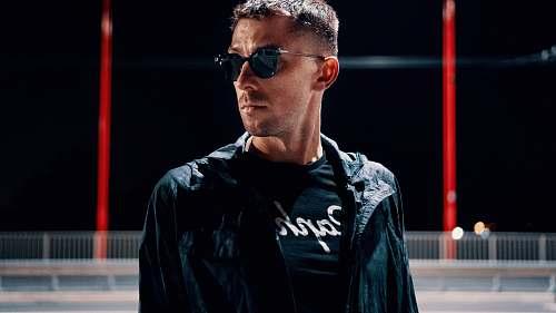people man wearing black jacket and sunglasses close-up photo human