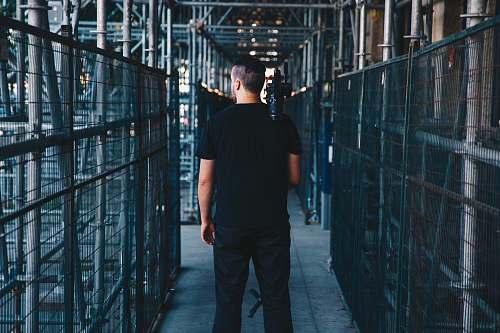 human man wearing black shirt people