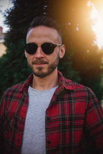 human man wearing black sunglasses and plaid shirt people
