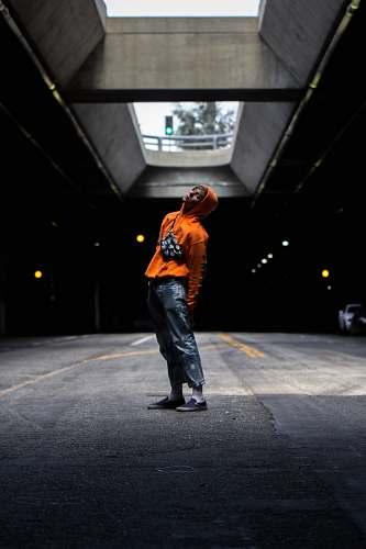 people man wearing orange hoodie human