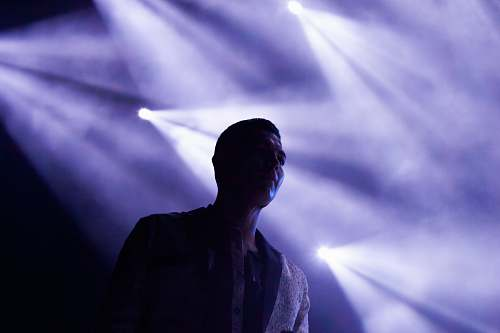 people man's silhouette on stage reflected by stage lights human