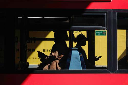 people people inside bus sitting while using smartphone human