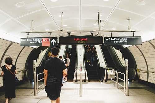 people people walking towards escalator inside Bus station human