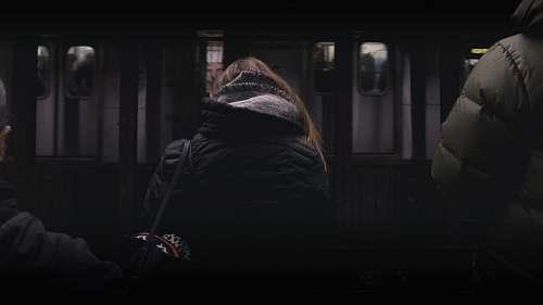 people person in black coat standing in front of white panel door human