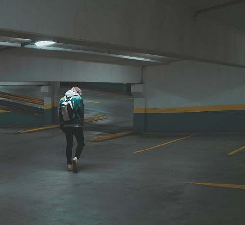 human person walking on underground parking area people