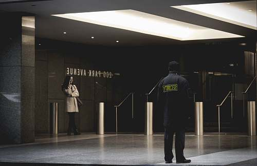 people security guard standing on the gray floor human