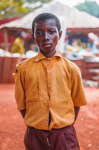human selective focus photo of boy standing people