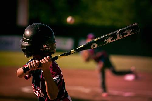 people selective focus photography of person holding baseball bat human