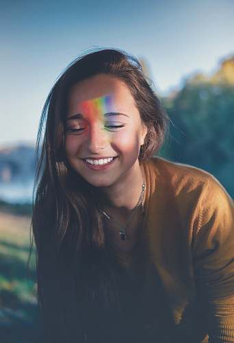 human shallow focus photography of smiling woman people