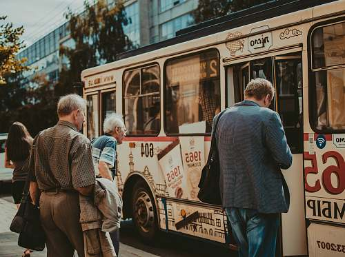 people three men standing outside bus human