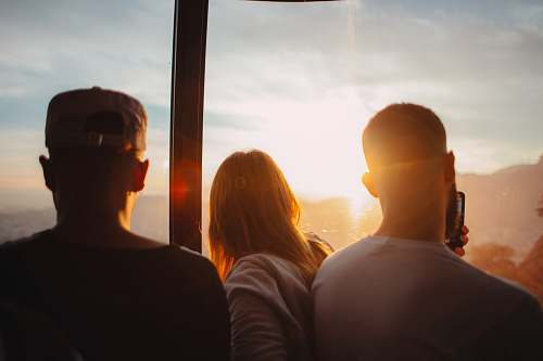 people three people standing each other during golden time human