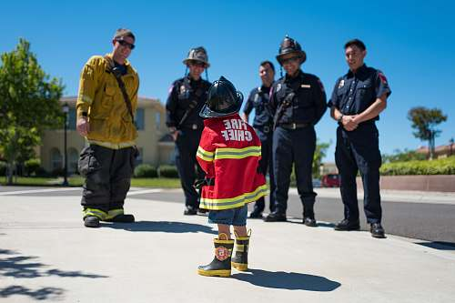 people toddler wearing red firefighter uniform human