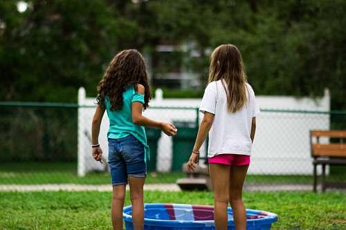 people two girls near round blue plastic basin human