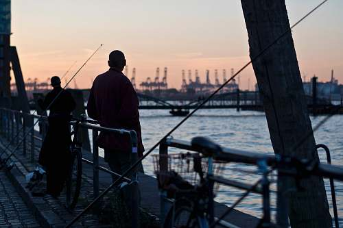 human two men fishing on dock people