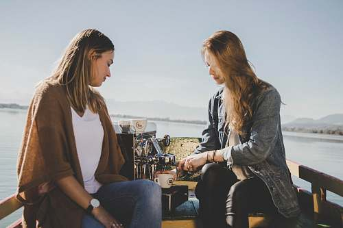 people two women on boat with espresso machine at sea human