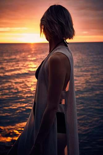 human woman facing sideways at sunset people