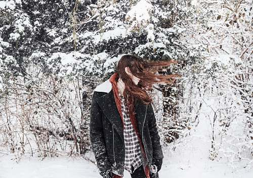 people woman facing sideways with hair covering her face snow
