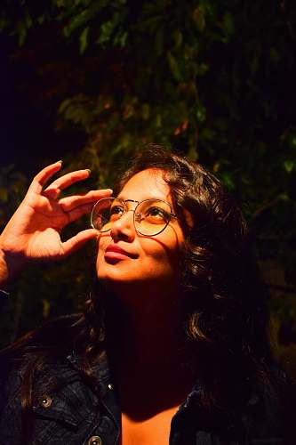 human woman holding her eyeglasses people