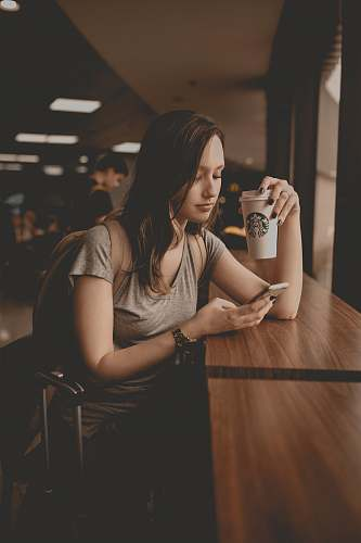 people woman holding starbucks disposable cup and smartphone human