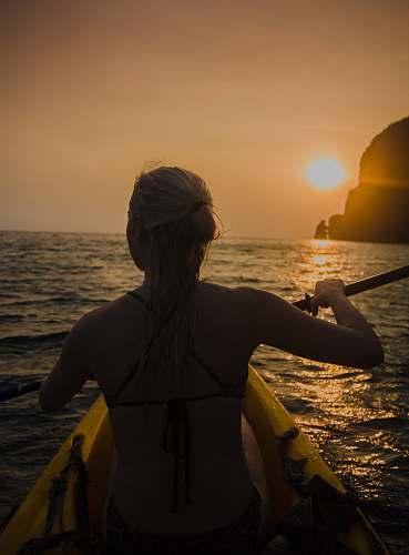 people woman kayaking facing sunset human