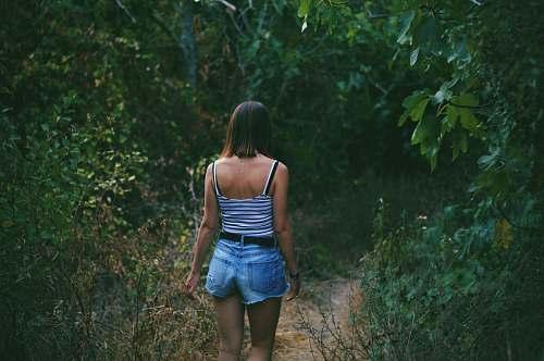 people woman on pathway between trees human