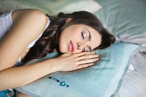 human woman sleeping on blue throw pillow people