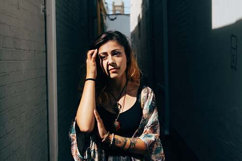 people woman standing between walls tattoo