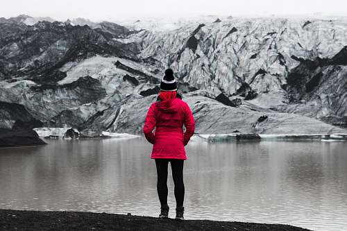 people woman standing in front of mountain covered with snow human