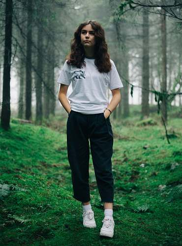 people woman standing in middle of forest human