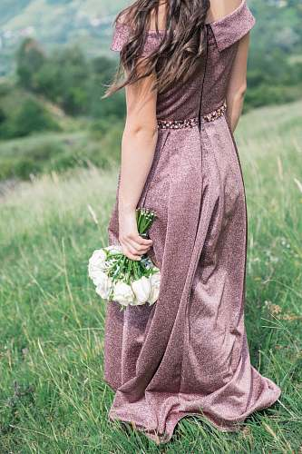 people woman standing on grass fields holding bouquet of white flowers human