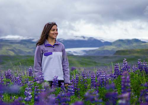 people woman standing on lavender flower field during daytime human