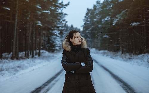 human woman standing on snow field people