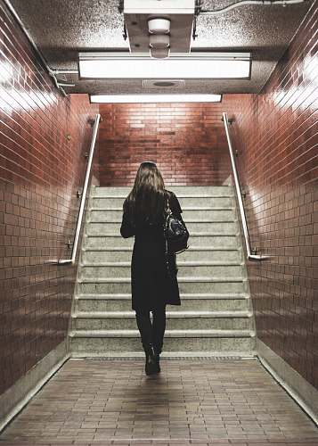 people woman walking near staircase human