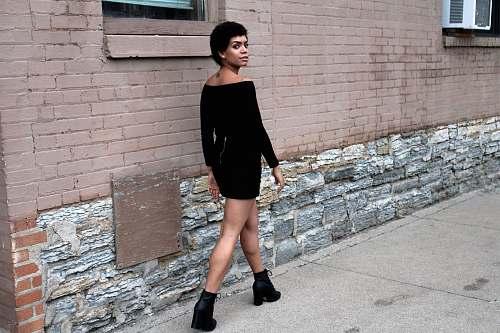 people woman walking near wall human