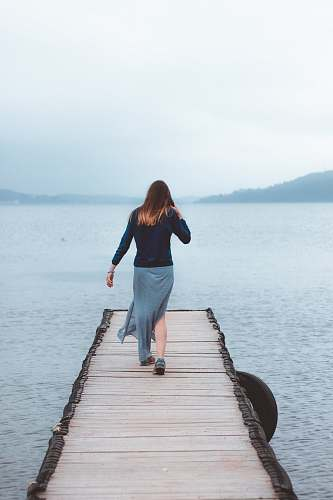 people woman walking on dock near water human