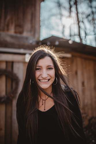 human woman wearing black shirt smiling photography people