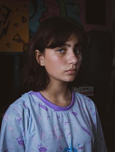 people woman wearing blue and purple shirt human