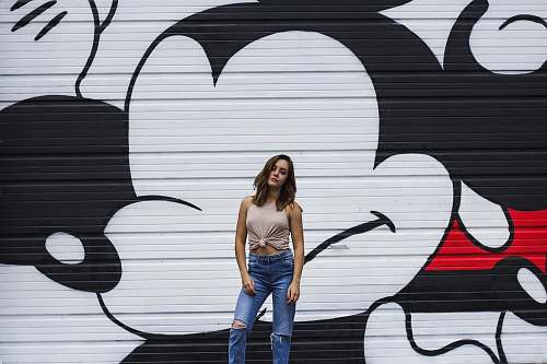 human woman wearing brown blouse with black and white Mickey Mouse graffiti at daytime people