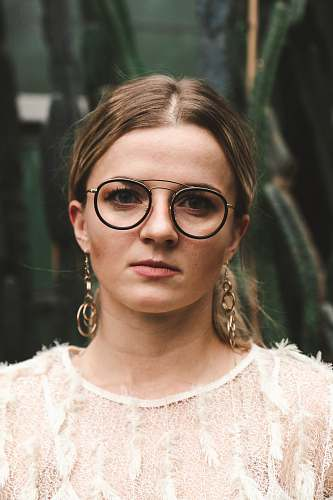 people woman wearing eyeglasses and white lace top glasses