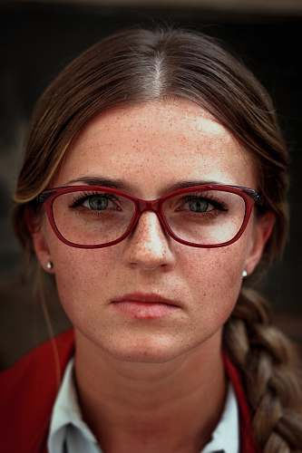 people woman wearing eyeglasses with red frames glasses