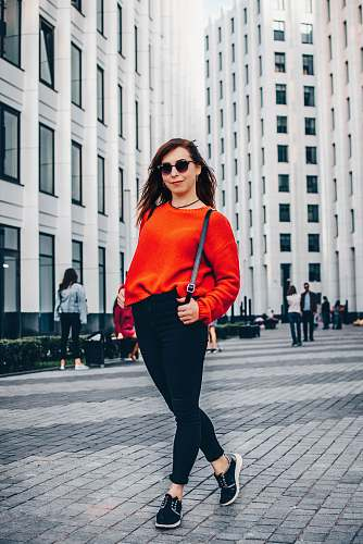 people woman wearing red sweatshirt human