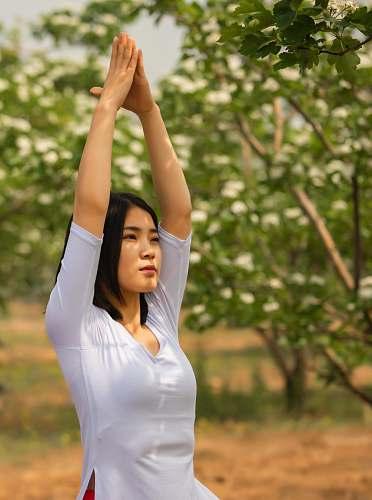 human woman doing yoga person