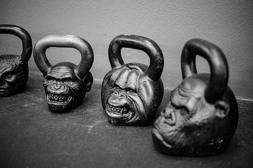 grey four apes kettlebells on pavement kirkfit gym